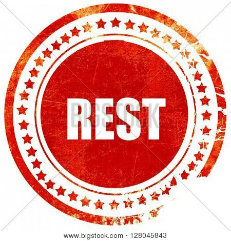 rest, grunge red rubber stamp on a solid white background