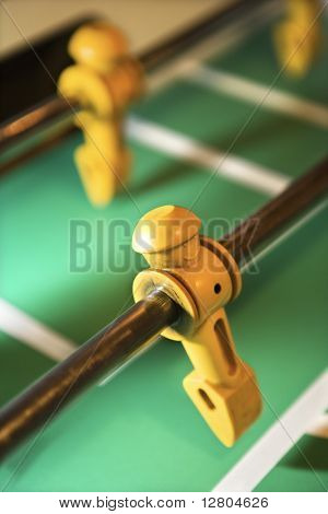 Player figurine on fooseball table.