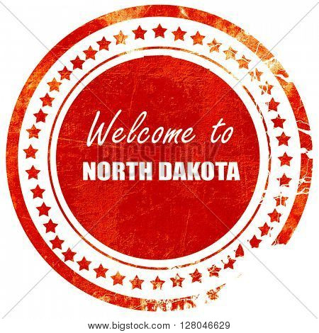 Welcome to north dakota, grunge red rubber stamp on a solid whit