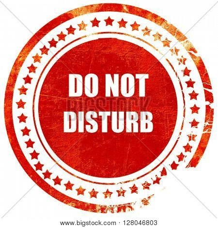Do not disturb sign, grunge red rubber stamp on a solid white ba