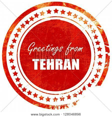 Greetings from tehran, grunge red rubber stamp  on a solid white background