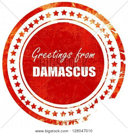Greetings from damascus, grunge red rubber stamp  on a solid white background