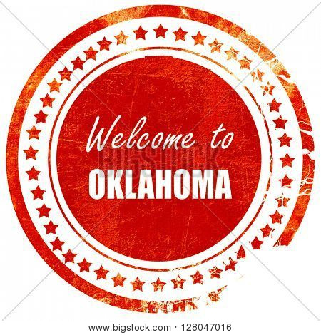 Welcome to oklahoma, grunge red rubber stamp  on a solid white background