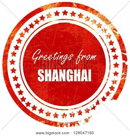 Greetings from shanghai, grunge red rubber stamp  on a solid white background