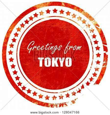 Greetings from tokyo, grunge red rubber stamp  on a solid white background