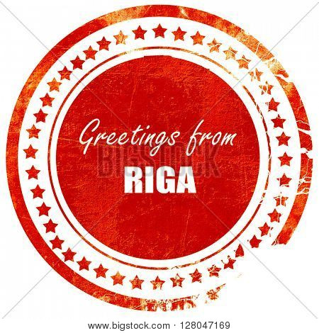 Greetings from riga, grunge red rubber stamp  on a solid white background