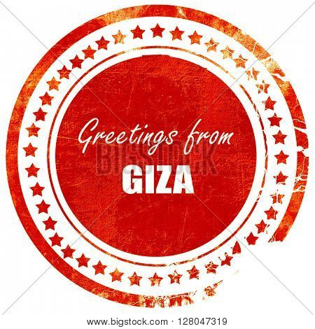 Greetings from giza, grunge red rubber stamp  on a solid white background