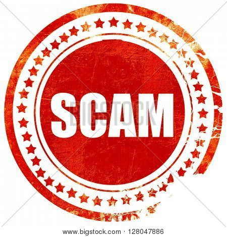 scam, grunge red rubber stamp on a solid white background