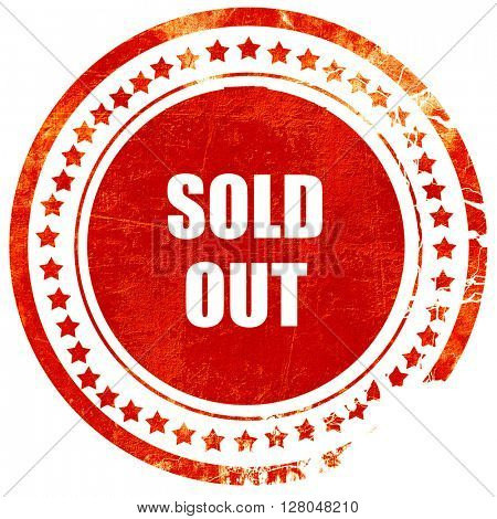 sold out sign, grunge red rubber stamp on a solid white background