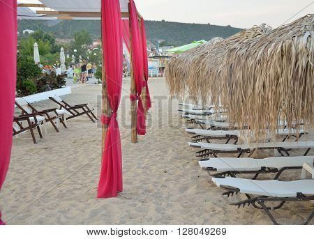 Sunbeds and parasols at the end of the day on the beach