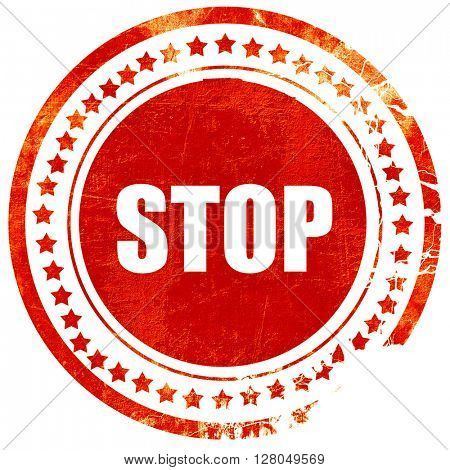 stop, grunge red rubber stamp on a solid white background