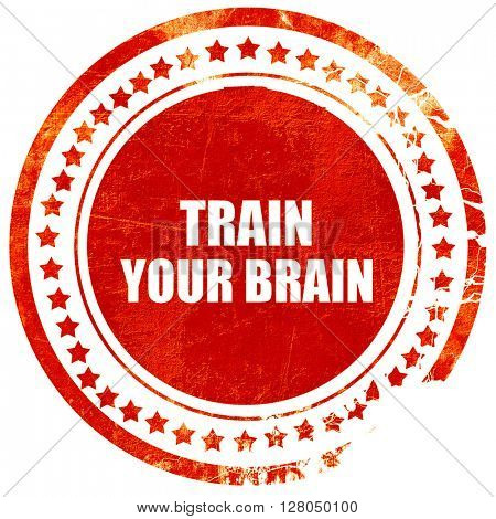 train your brain, grunge red rubber stamp on a solid white backg