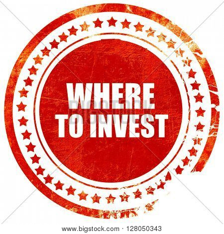 where to invest, grunge red rubber stamp on a solid white backgr