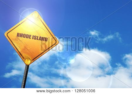 Yellow road sign with a blue sky and white clouds:  rhode island