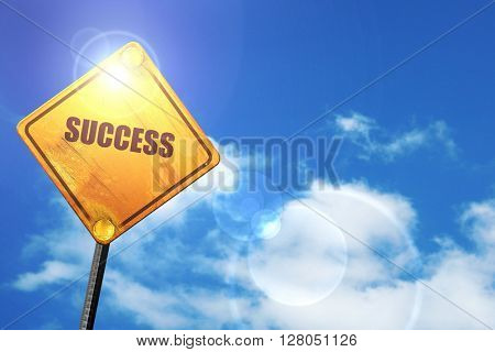 Yellow road sign with a blue sky and white clouds: Success sign