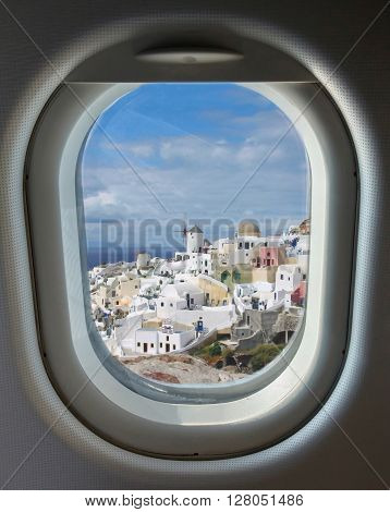 porthole and landmark island of Santorini in the summer