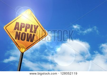 Yellow road sign with a blue sky and white clouds: apply now