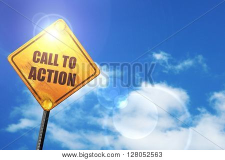Yellow road sign with a blue sky and white clouds: call to action