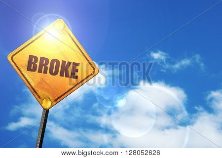 Yellow road sign with a blue sky and white clouds: broke
