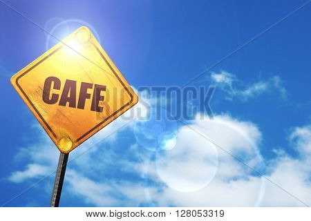 Yellow road sign with a blue sky and white clouds: cafe sign bac