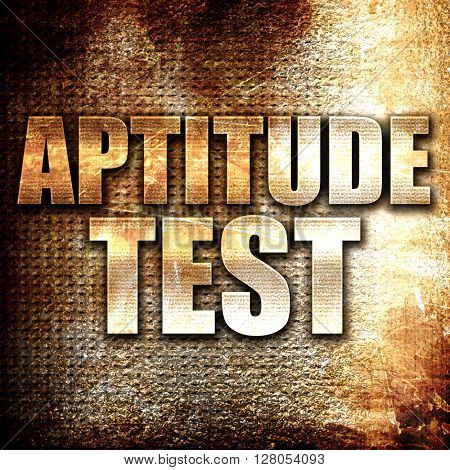 aptitude test, written on vintage metal texture