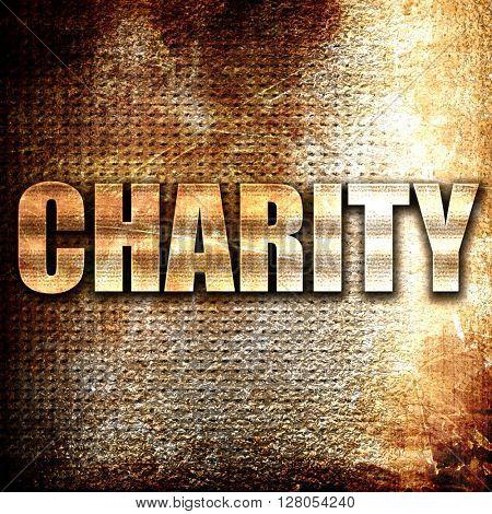 charity, written on vintage metal texture