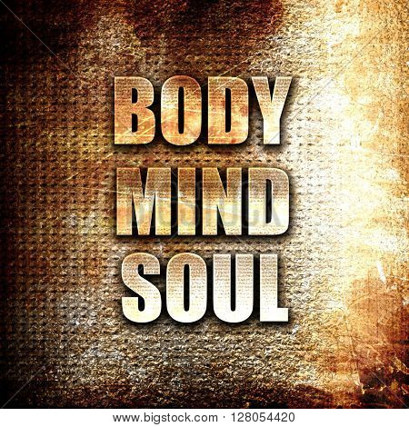 body mind soul, written on vintage metal texture