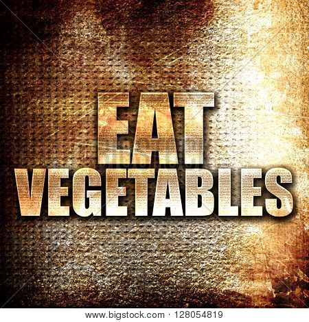 eat vegetables, written on vintage metal texture