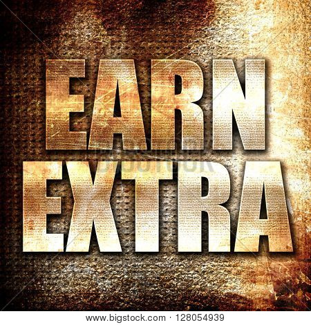 earn extra, written on vintage metal texture