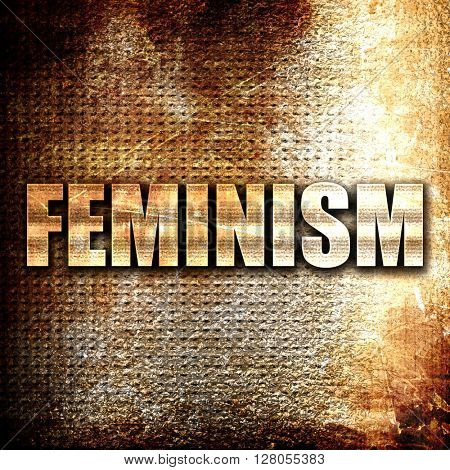 feminism, written on vintage metal texture