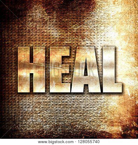 heal, written on vintage metal texture