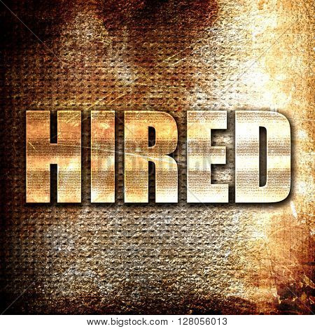 hired, written on vintage metal texture