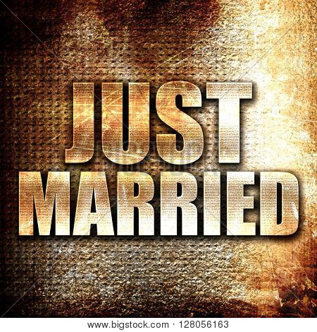 just married, written on vintage metal texture