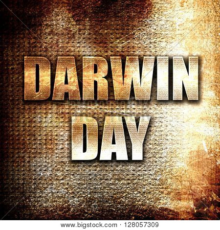 darwin day, written on vintage metal texture