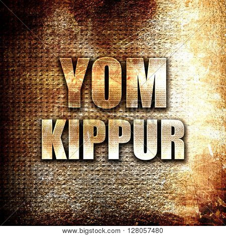 yom kippur, written on vintage metal texture