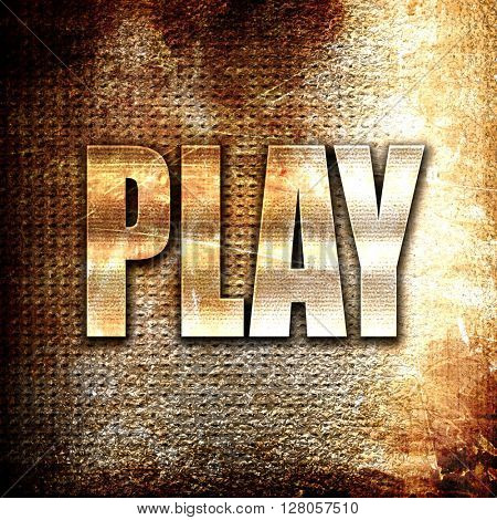 play, written on vintage metal texture