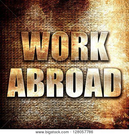 work abroad, written on vintage metal texture