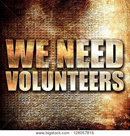 we need volunteers, written on vintage metal texture