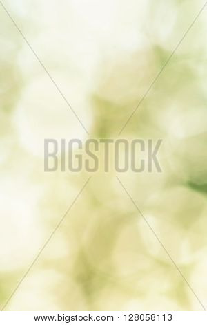 Abstract green background with white blurred shapes in the form of an octahedron