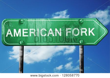 american fork road sign , worn and damaged look