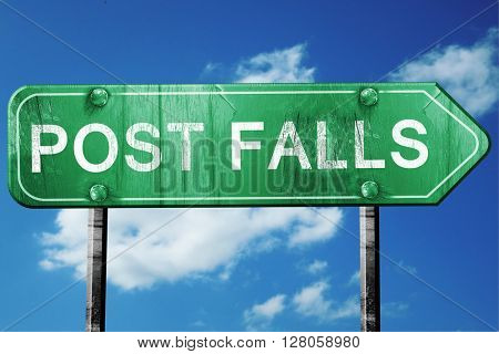 post falls road sign , worn and damaged look