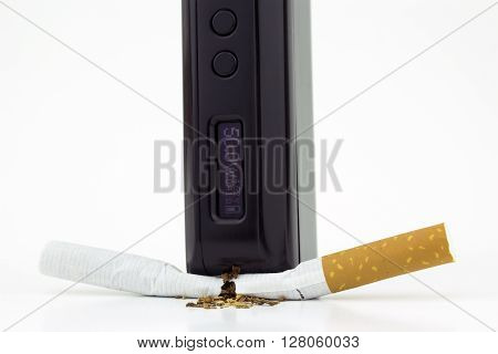 A box mod e-cigarette crushing a cigarette (close)