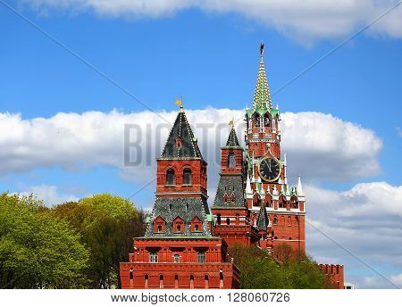 Towers of Moscow Kremlin behind red kremlin wall