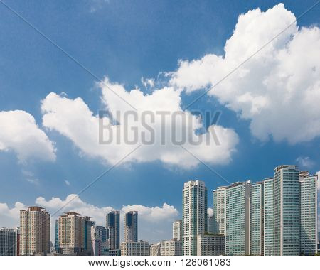 Modern city buildings with clouds above it