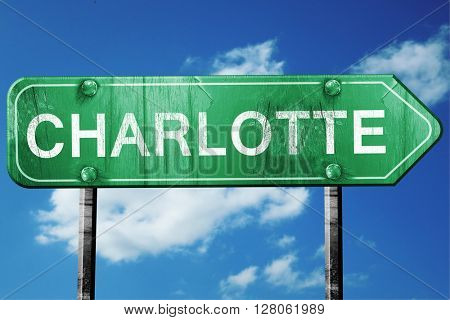 charlotte road sign , worn and damaged look