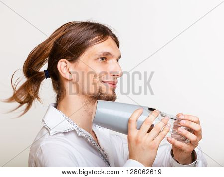 Long Haired Barman Shaking Head.
