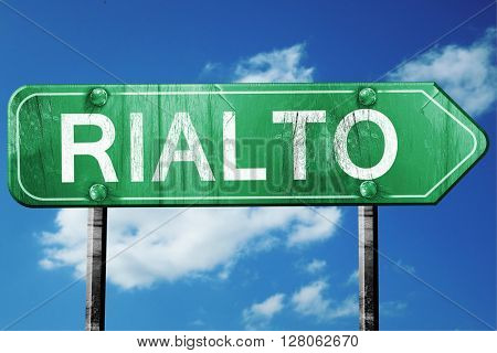 rialto road sign , worn and damaged look