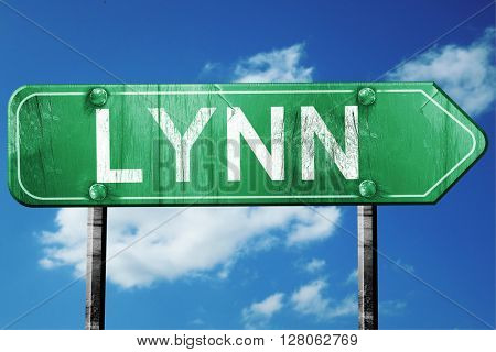 lynn road sign , worn and damaged look