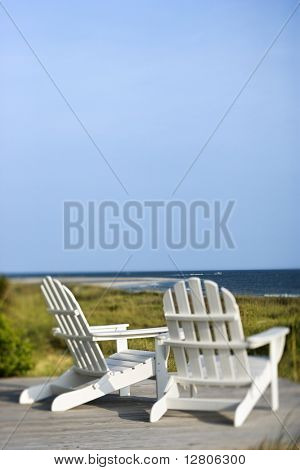 Adirondack chairs on deck looking towards beach on Bald Head Island, North Carolina.  *Web use