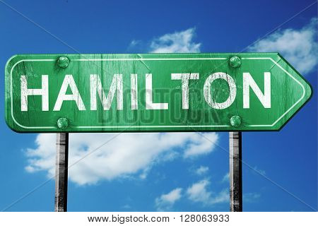 hamilton road sign , worn and damaged look